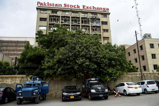 Police vehicles are park in front of the Pakistan Stock Exchange building following an attack by gunmen in Karachi on June 29, 2020. - At least six people were killed when gunmen attacked the Pakistan Stock Exchange in Karachi on June 29, with a policeman among the dead after the assailants opened fire and hurled a grenade at the trading floor, police said. (Photo by Rizwan TABASSUM / AFP) (Photo by RIZWAN TABASSUM/AFP via Getty Images)