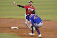 New York Mets' Jordan Yamamoto, right, is out at second as Miami Marlins shortstop Miguel Rojas, left, throws to first for a double play during the third inning of a baseball game, Sunday, May 23, 2021, in Miami. (AP Photo/Lynne Sladky)