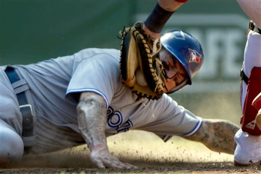 Toronto Blue Jays' Brett Lawrie slides safely at home on a single hit by Colby Rasmus as Boston Red Sox catcher Jarrod Saltalamacchia, right, tries to make the play in the eighth inning of a baseball game at Fenway Park, in Boston, Sunday, July 22, 2012. The Blue Jays won 15-7. (AP Photo/Steven Senne)