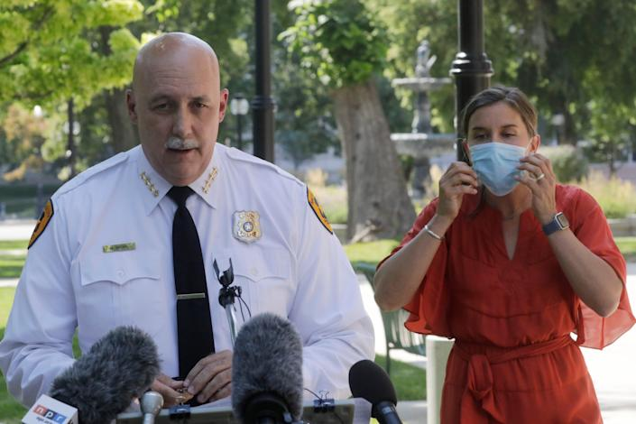 In this Aug. 3, 2020 file photo, Salt Lake City police Chief Mike Brown speaks as Mayor Erin Mendenhal listens during a news conference on Aug. 3, 2020, in Salt Lake City. The Salt Lake City Police Department vowed Tuesday, Sept. 8, 2020, to cooperate with multiple investigations of the shooting of a 13-year-old autistic boy by officers in the Salt Lake City area. The Salt Lake City Police Department said the officers were called to a home in Glendale, Utah, Friday night, Sept. 4 with a report of a boy who had threatened people with a weapon. The boy reportedly ran and was shot by an officer after being pursued by police.