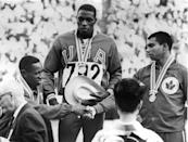 <p>Robert Hayes of the U.S.A. (center) wins gold for the Men's 100 Meters final. Enrique Figuerola of Cuba (left) wins silver and congratulates Harry Jerome of Canada (right), who wins bronze.</p>
