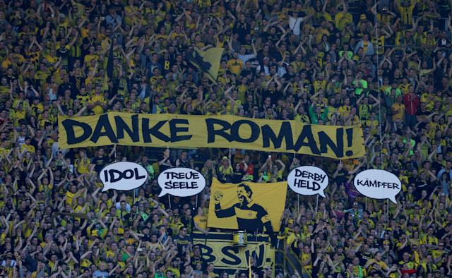 Soccer Football - Bundesliga - Borussia Dortmund vs 1.FSV Mainz 05 - Signal Iduna Park, Dortmund, Germany - May 5, 2018 Borussia Dortmund fans with a banner for Roman Weidenfeller during the match REUTERS/Leon Kuegeler DFL RULES TO LIMIT THE ONLINE USAGE DURING MATCH TIME TO 15 PICTURES PER GAME. IMAGE SEQUENCES TO SIMULATE VIDEO IS NOT ALLOWED AT ANY TIME. FOR FURTHER QUERIES PLEASE CONTACT DFL DIRECTLY AT + 49 69 650050