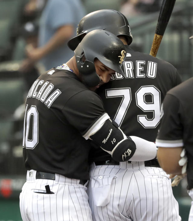 Chicago White Sox's Yoan Moncada, left, hugs Jose Abreu after Moncada's home run off Cleveland Indians starting pitcher Adam Plutko during the first inning of a baseball game Tuesday, June 12, 2018, in Chicago. (AP Photo/Charles Rex Arbogast)