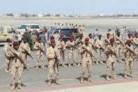 Military personnel were waiting to welcome members of the new unity government before explosions rocked the Yemeni airport