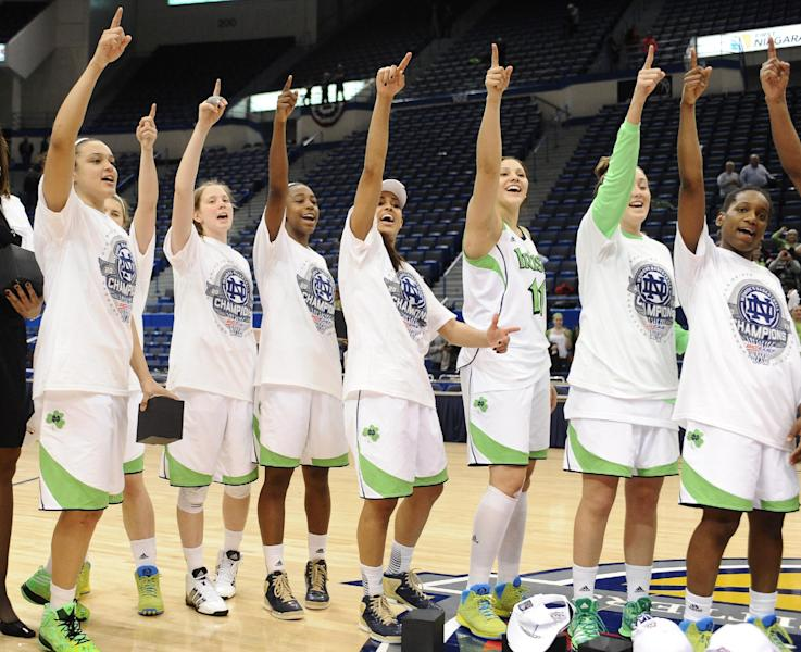 Notre Dame celebrates their Big East Conference women's tournament championship win over Connecticut in an NCAA college basketball game in Hartford, Conn., Tuesday, March 12, 2013. (AP Photo/Jessica Hill)