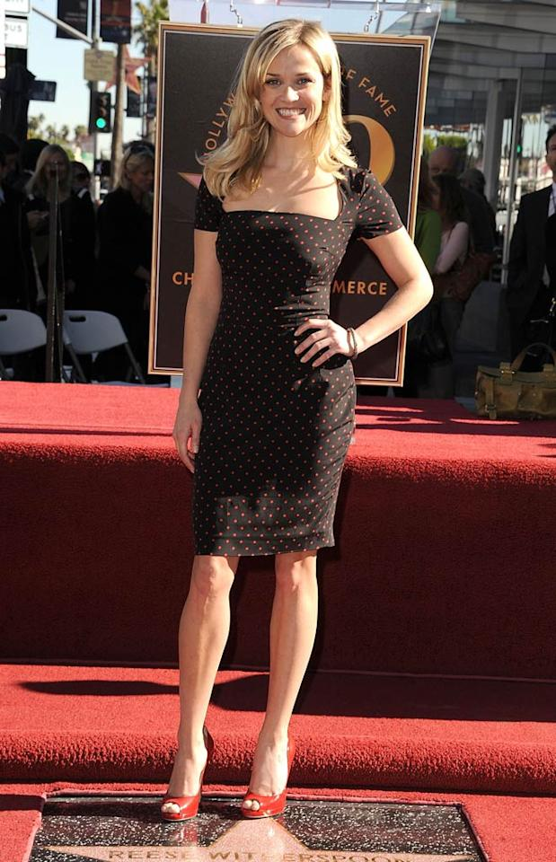 """Back in L.A., Carrie's BFF Reese Witherspoon looked cute as can be in a polka dotted Dolce & Gabbana dress and Jimmy Choo heels as she accepted her star on the Hollywood Walk of Fame. Steve Granitz/<a href=""""http://www.wireimage.com"""" target=""""new"""">WireImage.com</a> - December 1, 2010"""