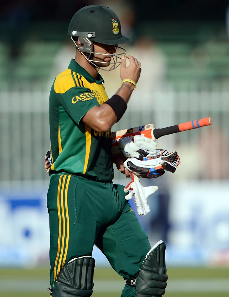 South African cricketer JP Duminy walks back to the pavilion after being caught out by Pakistan's wicket keeper Umar Akmal (unseen) during the first one-day in Sharjah Cricket Stadium in Sharjah on October 30, 2013. South African captain AB de Villiers won the toss and decided to bat in the first of five one-day internationals against Pakistan in Sharjah . AFP PHOTO/ Asif HASSAN        (Photo credit should read ASIF HASSAN/AFP/Getty Images)