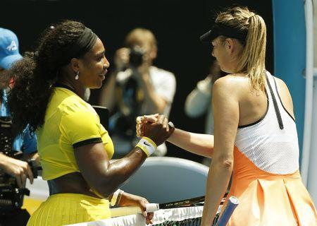 Serena Williams of the U.S. (L) and Russia's Maria Sharapova shake hands after Williams won their quarter-final match at the Australian Open tennis tournament at Melbourne Park, Australia, January 26, 2016. REUTERS/Issei Kato