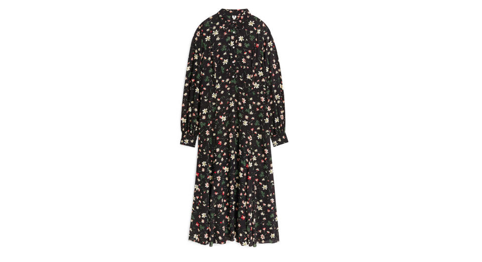 """<p>Every woman needs a good few floral, long dresses in her wardrobe. This one from Arket ticks all the boxes. <a rel=""""nofollow noopener"""" href=""""https://www.arket.com/en_gbp/women/dresses/product.floral-print-cr%C3%AApe-dress-black.0544803001.html"""" target=""""_blank"""" data-ylk=""""slk:Buy here."""" class=""""link rapid-noclick-resp""""><em>Buy here</em>.</a> </p>"""