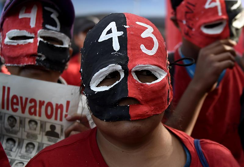 Masked students take part in a demonstration demanding information on the whereabouts of the 43 missing students from Ayotzinapa, in Mexico City on November 5, 2014 (AFP Photo/Ronaldo Schemidt)