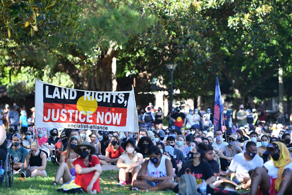 Indigenous and non-indigenous protesters during an Invasion Day rally in The Domain, Sydney. Source: AAP