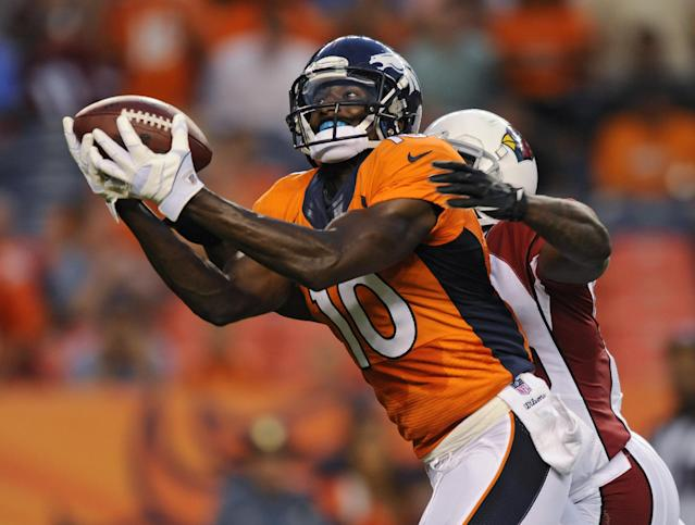 Denver Broncos wide receiver Gerell Robinson (10) catches a pass as Arizona Cardinals' Javier Arenas defends during the first quarter of a preseason NFL football game, Thursday, Aug. 29, 2013, in Denver. (AP Photo/Jack Dempsey)
