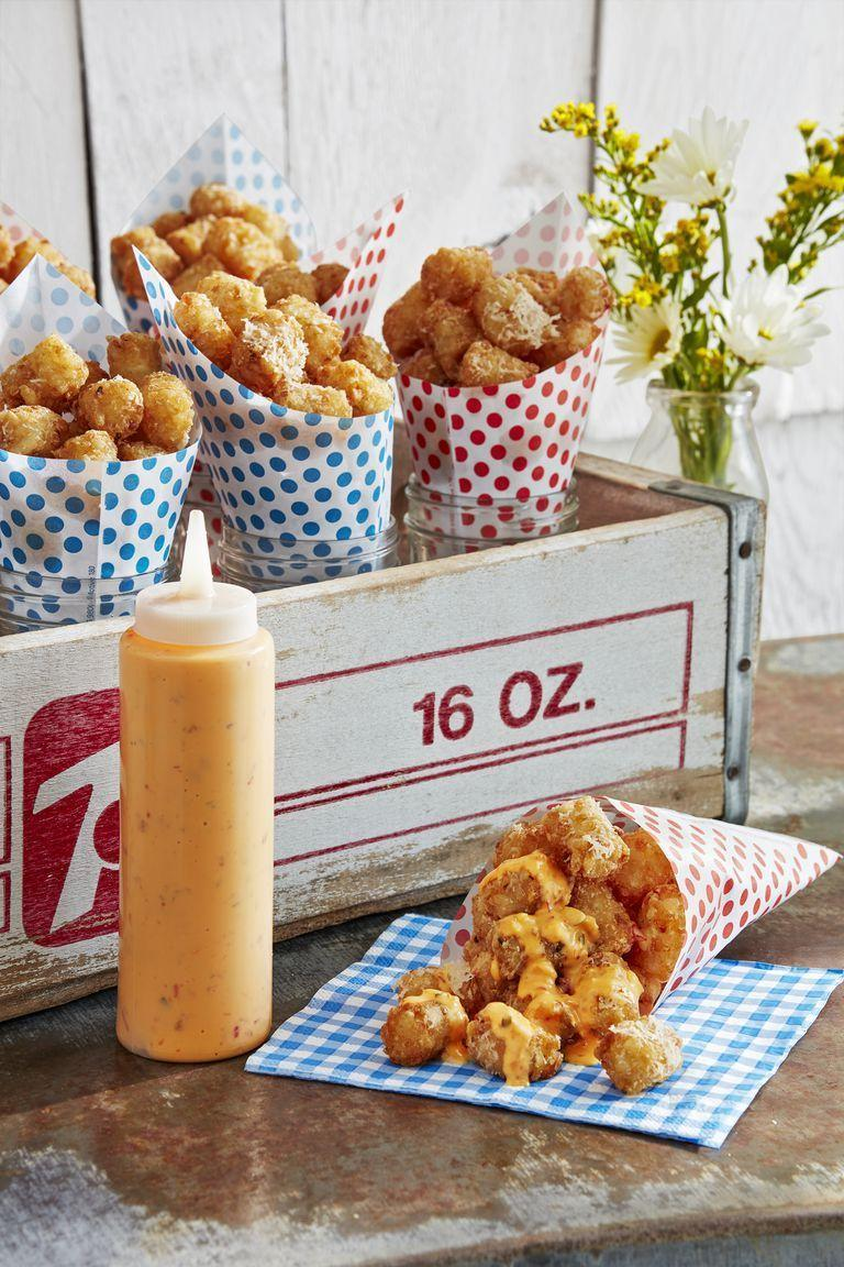 """<p>It's impossible to resist these cheesy tots. The kids will especially enjoy chowing down on this crispy side.</p><p><strong><a href=""""https://www.countryliving.com/food-drinks/a27546024/parmesan-tots-with-dipping-sauce-recipe/"""" rel=""""nofollow noopener"""" target=""""_blank"""" data-ylk=""""slk:Get the recipe"""" class=""""link rapid-noclick-resp"""">Get the recipe</a>.</strong> </p>"""