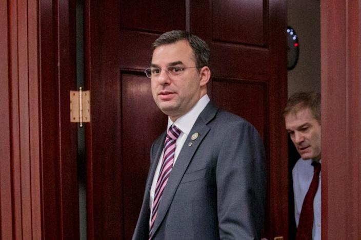 Rep. Justin Amash, R-Mich., followed by Rep. Jim Jordan, R-Ohio, leaving a closed-door strategy session on Capitol Hill, March 28, 2017. (AP Photo/J. Scott Applewhite, File)