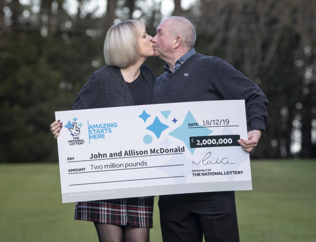John and Allison McDonald, from Stockton On Tees, celebrating their £2 million Lotto jackpot win at Crathorne Hall, North Yorkshire (Picture: PA)