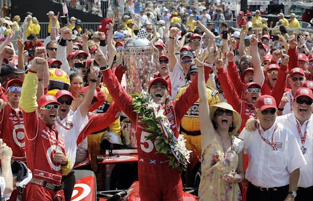 FILE- In this May 27, 2012, file photo, IndyCar driver Dario Franchitti, center, of Scotland, celebrates with his crew after winning the Indianapolis 500 auto race at the Indianapolis Motor Speedway in Indianapolis. The three-time Indianapolis 500 winner said Thursday, Nov. 14, 2013, that doctors have told him he can no longer race because of injuries sustained in an IndyCar crash last month. He fractured his spine, broke his right ankle and suffered a concussion in the Oct. 6 crash at Houston. (AP Photo/Darron Cummings, File)