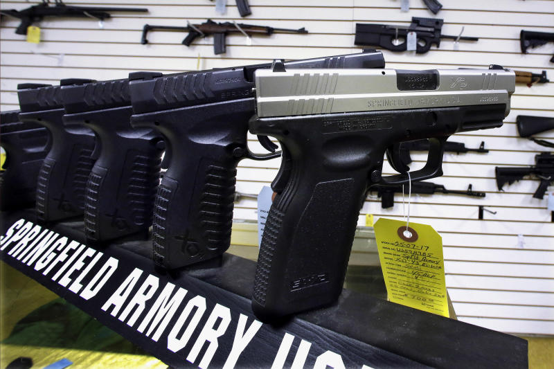 In this Wednesday, Jan. 16, 2013 photo, semi-automatic handguns are seen on display at Capitol City Arms Supply in Springfield, Ill. The window for Illinois communities to ban assault weapons within their boundaries appears to be closing quickly. But few cities seem concerned. Legislation allowing the carrying of concealed weapons that could take effect July 9, 2013 includes a provision giving cities ten days to enact prohibitions on assault-style weapons. (AP Photo/Seth Perlman)