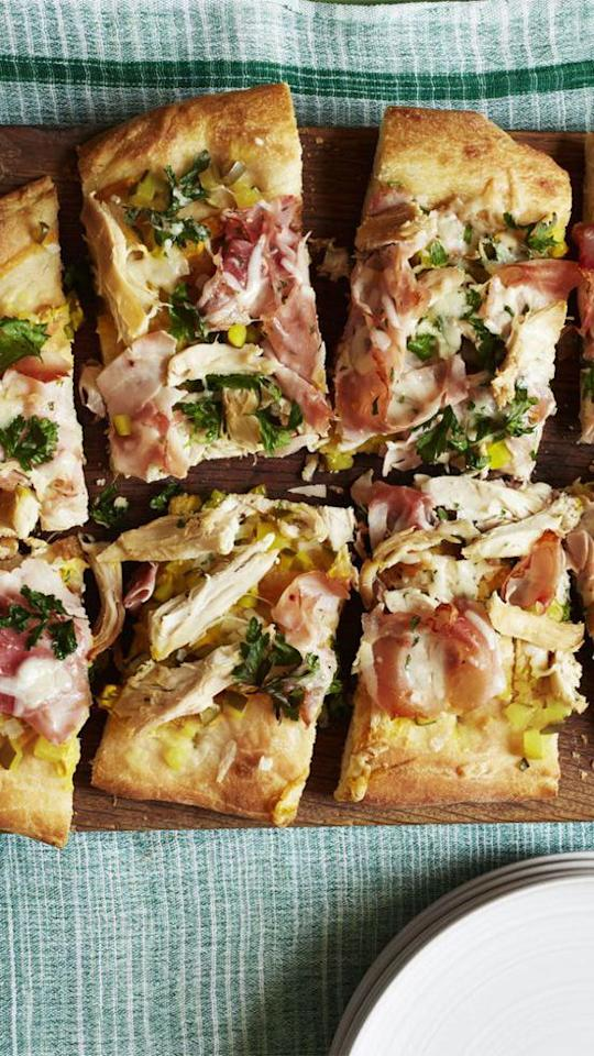 """<p>Every slice of this pizza is piled high with chicken, ham, Gruyère, and fresh veggies. There's no doubt it'll be a hit with the whole crew. </p><p><strong><a rel=""""nofollow"""" href=""""https://www.womansday.com/food-recipes/food-drinks/recipes/a56182/pizza-cubano-recipe/"""">Get the recipe.</a></strong></p>"""
