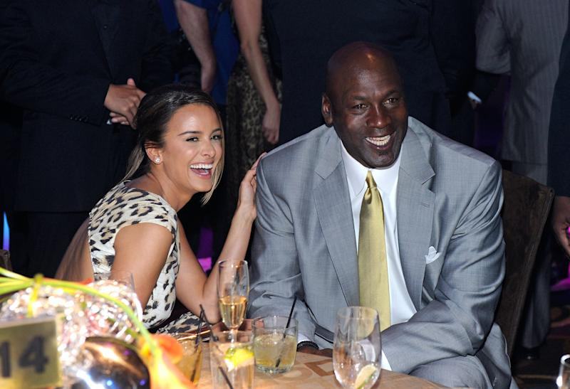 LAS VEGAS, NV - MARCH 30: Charlotte Bobcats owner Michael Jordan (R) and fiancee Yvette Prieto attend the 11th annual Michael Jordan Celebrity Invitational gala at the Aria Resort & Casino at CityCenter March 30, 2011 in Las Vegas, Nevada. (Photo by Ethan Miller/Getty Images for MJCI)
