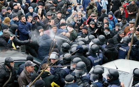 <span>Police spray tear gas at protesters who tried to prevent a van from taking Mr Saakashvili away.</span> <span>Credit: Gleb Garanich/Reuters </span>