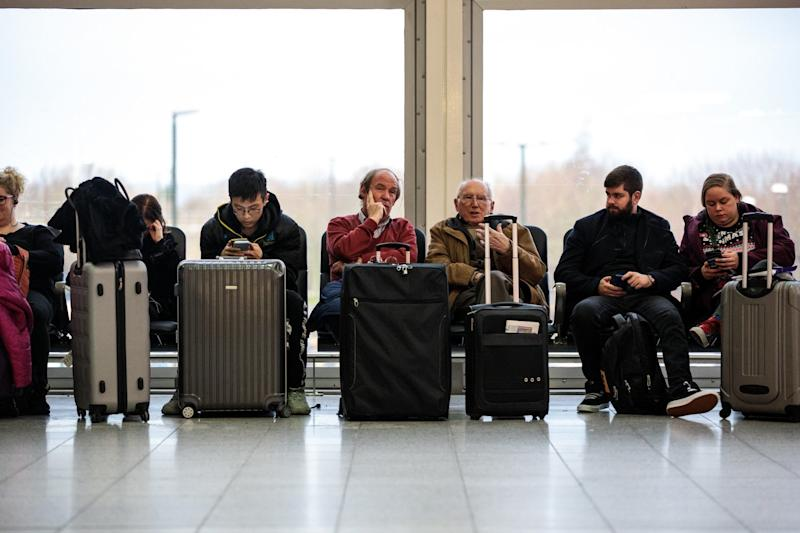 Passengers wait in the South Terminal building at London Gatwick (Getty Images)