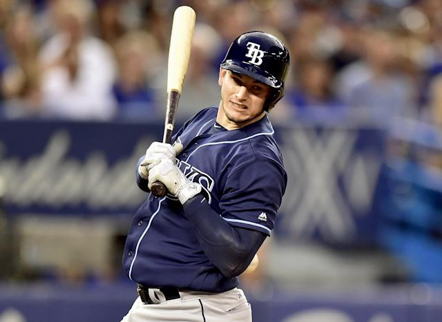 <p>Tampa Bay Rays' Daniel Robertson reacts as he is hit in the lower back by a pitch during fourth-inning baseball game action against the Toronto Blue Jays in Toronto, Monday, Aug. 14, 2017. (Frank Gunn/The Canadian Press via AP) </p>