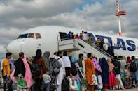 Evacuees board a plane on Ramstein air base bound for the United States (AFP/Edgar GRIMALDO)