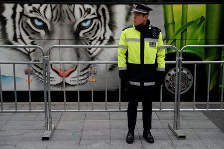 A policeman waits for a convoy transporting South Korean President Moon Jae-in to leave the Presidential Blue House for the inter-Korean summit, in Seoul, South Korea, April 27, 2018.