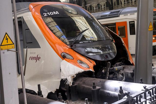 <p>The damaged front wagon is seen at the Estacio de Franca (Franca station) in central Barcelona on July 28, 2017 after a regional train appears to have hit the end of the track inside the station injuring dozens of people. (Photo: Miquel Llop/NurPhoto via Getty Images) </p>