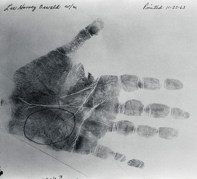 <p>Lee Harvey Oswald palm print taken on Nov. 22, 1963, the day President Kennedy was assassinated and the day Oswald, the alleged assassin, was arrested. The circled portion shows the print fragment that was on the cardboard box in the Texas School Book Depository, the site the assassin's bullets were fired from according to the Warren Commission. Oswald was shot by Jack Ruby two days after this print was taken. (Photo: Corbis via Getty Images) </p>