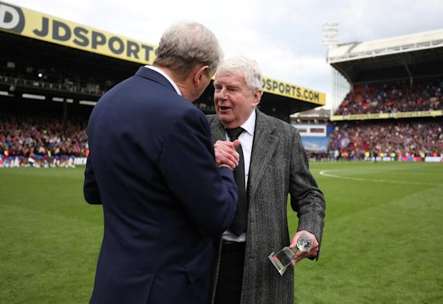 "Soccer Football - Premier League - Crystal Palace vs West Bromwich Albion - Selhurst Park, London, Britain - May 13, 2018 Crystal Palace manager Roy Hodgson presents an award to commentator John Motson after the match REUTERS/Hannah McKay EDITORIAL USE ONLY. No use with unauthorized audio, video, data, fixture lists, club/league logos or ""live"" services. Online in-match use limited to 75 images, no video emulation. No use in betting, games or single club/league/player publications. Please contact your account representative for further details."