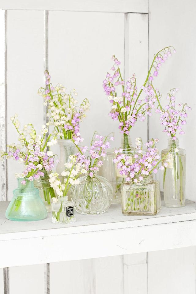 """<p>Don't throw out those empty perfume bottles sitting on your vanity! Lilies of the valley look beautiful arranged in these glass vessels, and they're perfect for Easter.</p><p><a class=""""body-btn-link"""" href=""""https://www.amazon.com/Vintage-Refillable-Perfume-Bottles-Wedding/dp/B01L6DCIQ8?tag=syn-yahoo-20&ascsubtag=%5Bartid%7C10050.g.1652%5Bsrc%7Cyahoo-us"""" target=""""_blank"""">SHOP EMPTY PERFUME BOTTLES</a></p>"""