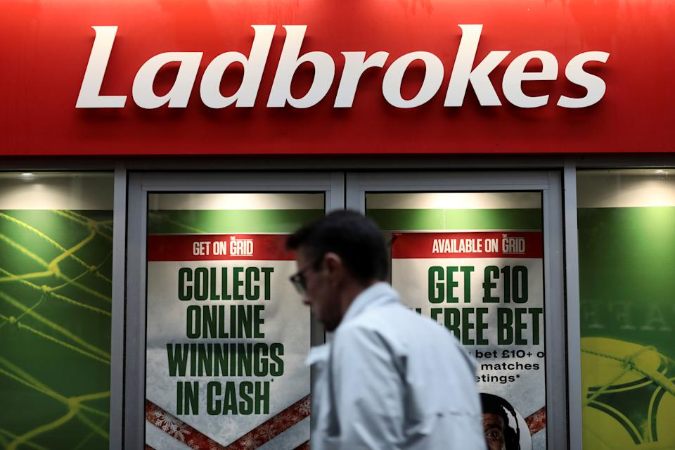 A pedestrian walks past a branch of Ladbrokes in London, Britain December 22, 2017. REUTERS/Simon Dawson