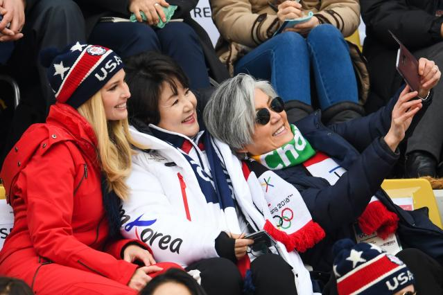 <p>Ivanka Trump (L), wife of Korean President Moon Jae-in, Kim Jung-sook (C) and Korean foreign minister Kang Kyung-wha (R)takes a selfie while watching the final of the men's snowboard big air event at the Alpensia Ski Jumping Centre during the Pyeongchang 2018 Winter Olympic Games on February 24, 2018 in Pyeongchang. / AFP PHOTO / FRANCK FIFE </p>