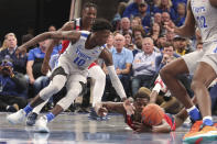 Memphis Damion Baugh (10) and Illinois-Chicago Travell Washington (35) go for a loose ball during the second half of an NCAA college basketball game, Friday, Nov. 8, 2019, in Memphis, Tenn. (AP Photo/Karen Pulfer Focht)