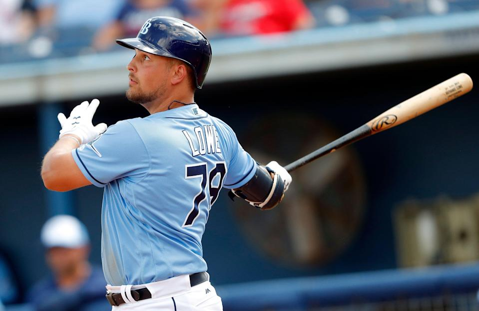 Tampa Bay Rays' Nate Lowe follows through on a solo home run int he sixth inning of a spring training baseball game against the Boston Red Sox, Sunday, March 10, 2019, in Port Charlotte, Fla. (AP Photo/John Bazemore)