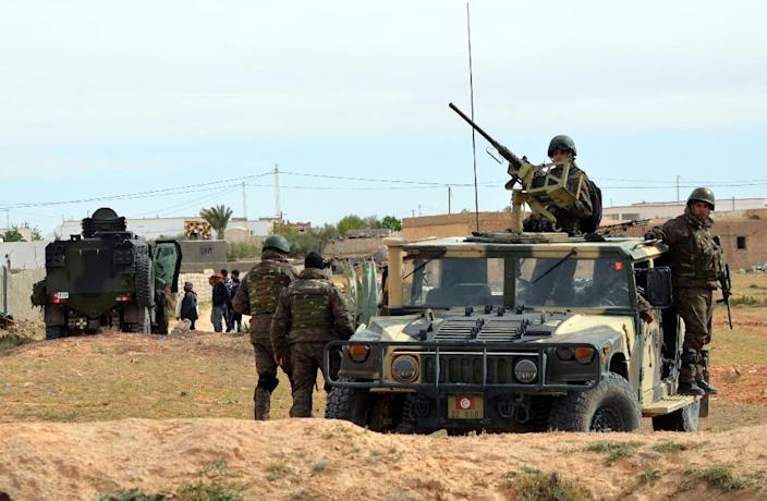 Tunisian special forces patrol in the southern town of Ben Guerdane, near the Libyan border, during clashes with jihadists on March 8, 2016 a day after an attack on the border town (AFP Photo/Fathi Nasri)