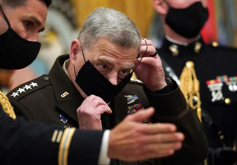 Chairman of the Joint Chiefs of Staff Gen. Mark Milley puts his face mask back on after a ceremony where U.S. President Donald Trump presented the Medal of Honor to U.S. Army Sgt. Maj. Thomas P. Payne for conspicuous gallantry during a hostage rescue mission in Iraq, at the White House in Washington, U.S., September 11, 2020. (Kevin Lamarque/Reuters)