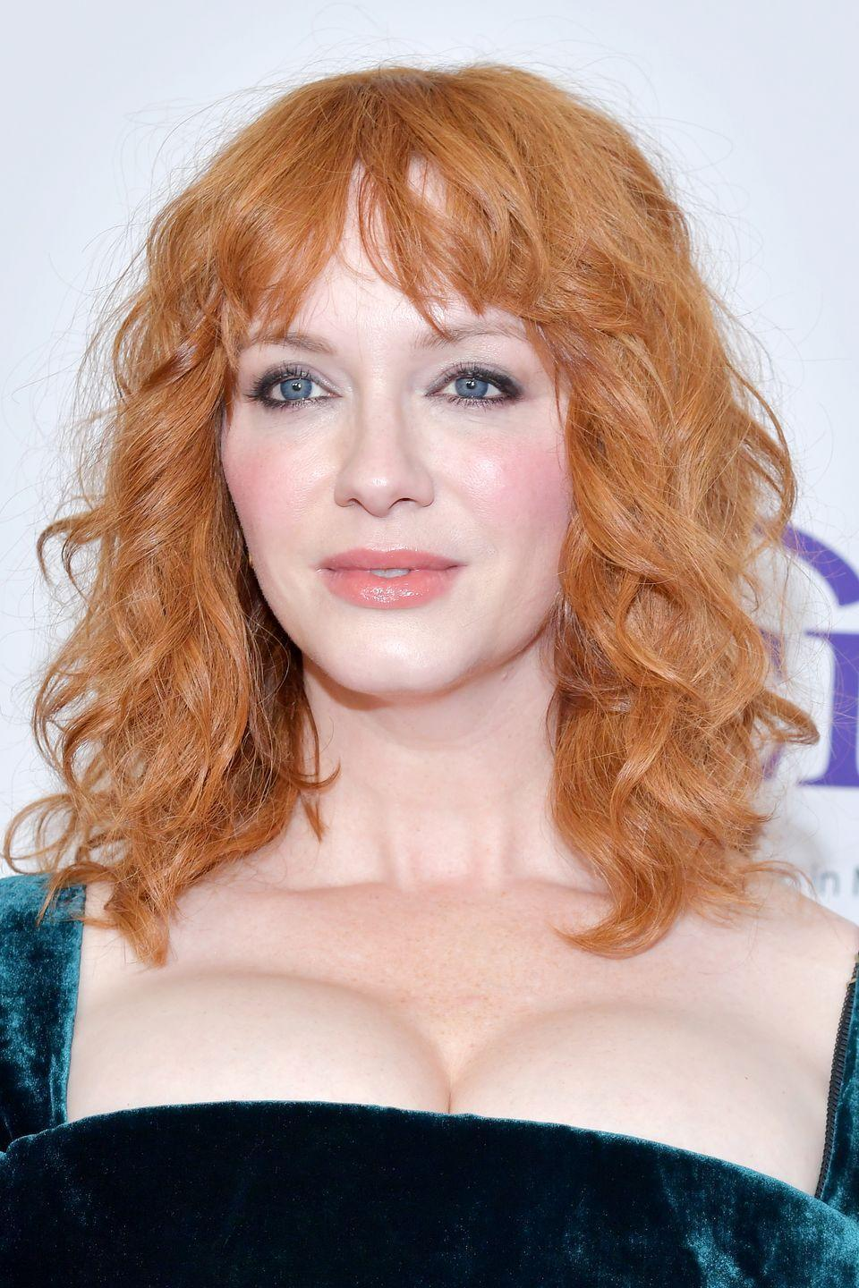 <p>We're seeing corals and reds this year, so it's almost inevitable that people will start to copy the color of their favorite order at Starbucks. Just check out <strong>Christina Hendricks</strong>'s hair, which has a reddish tone with a splash of cream. </p>