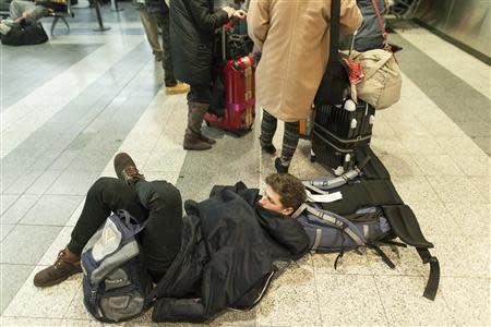 People wait for their delayed flights at LaGuardia Airport in New York January 3, 2014. REUTERS/Zoran Milich