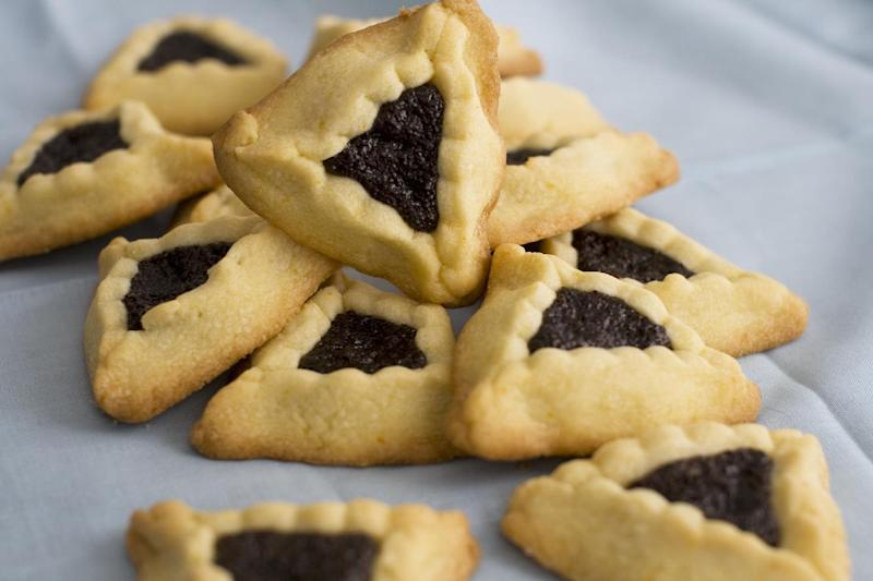 This image taken on Jan. 30, 2012 in Concord, N.H. shows triangular-shaped orange-poppy seed hamantashen cookies, a favorite for the Jewish holiday Purim. (AP Photo/Matthew Mead)