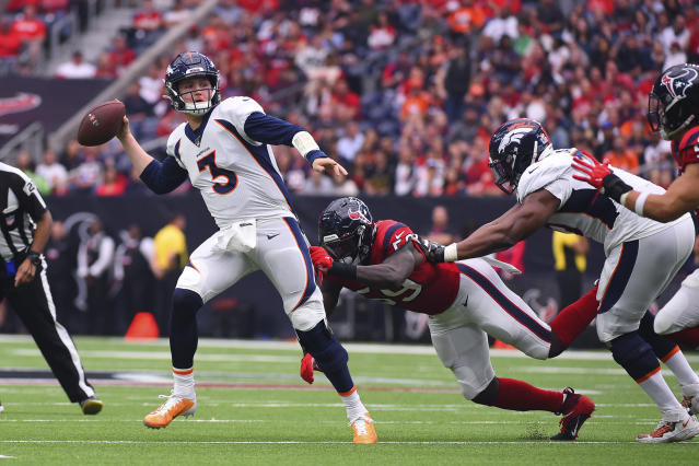 Denver Broncos quarterback Drew Lock (3) throws as he is pressured by Houston Texans outside linebacker Whitney Mercilus (59) during the first half of an NFL football game Sunday, Dec. 8, 2019, in Houston. (AP Photo/Eric Christian Smith)