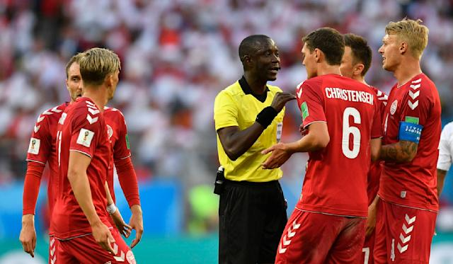 <p>Who's the boss? Referee Bakari Gassama lays down the law to Andreas Christensen and his Danish teammates. (AP) </p>
