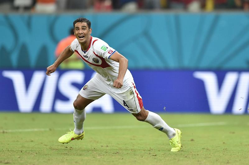 Costa Rica's defender Michael Umana celebrates after wining a Round of 16 match between Costa Rica and Greece at Pernambuco Arena in Recife during the 2014 FIFA World Cup on June 29, 2014