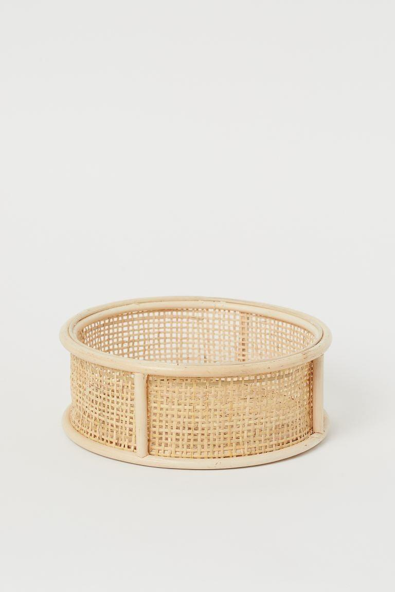"<p>You can keep your keys and more in the<a href=""https://www.popsugar.com/buy/HampM-Round-Rattan-Storage-Basket-584973?p_name=H%26amp%3BM%20Round%20Rattan%20Storage%20Basket&retailer=www2.hm.com&pid=584973&price=30&evar1=casa%3Aus&evar9=45784601&evar98=https%3A%2F%2Fwww.popsugar.com%2Fhome%2Fphoto-gallery%2F45784601%2Fimage%2F47575738%2FHM-Round-Rattan-Storage-Basket&list1=shopping%2Cproducts%20under%20%2450%2Cdecor%20inspiration%2Caffordable%20shopping%2Chome%20shopping&prop13=api&pdata=1"" class=""link rapid-noclick-resp"" rel=""nofollow noopener"" target=""_blank"" data-ylk=""slk:H&amp;M Round Rattan Storage Basket"">H&amp;M Round Rattan Storage Basket</a> ($30).</p>"
