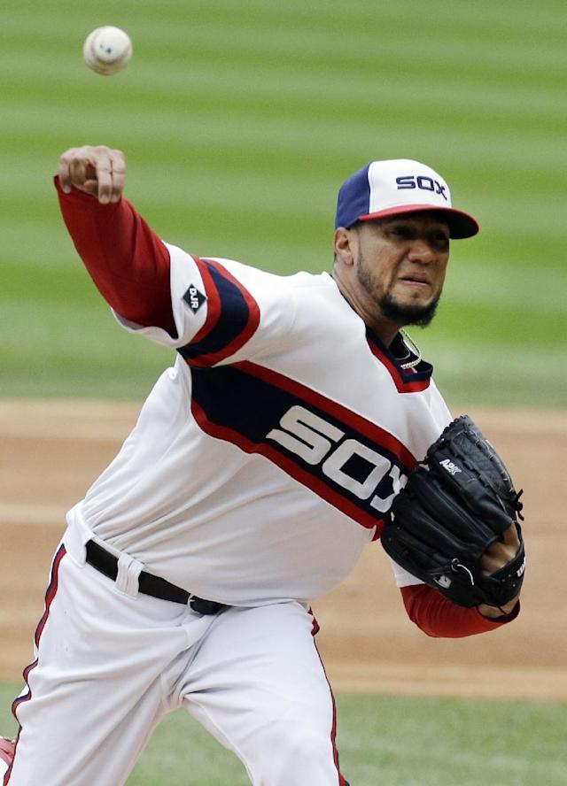 Chicago White Sox starter Hector Noesi throws against the Detroit Tigers during the first inning of a baseball game in Chicago on Wednesday, April 30, 2014. (AP Photo/Nam Y. Huh)