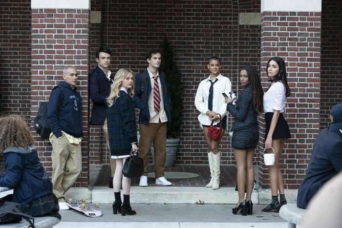 The new cast of Gossip Girl gathered around the courtyard at school