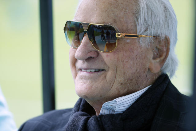 FILE - In this Nov. 17, 2019, file photo, former Miami Dolphins head coach Don Shula watches the team before an NFL football game against the Buffalo Bills in Miami Gardens, Fla. Shula, who won the most games of any NFL coach and led the Miami Dolphins to the only perfect season in league history, died Monday, May 4, 2020, at his home in Indian Creek, Fla., the team said. He was 90. (AP Photo/Wilfredo Lee, File)