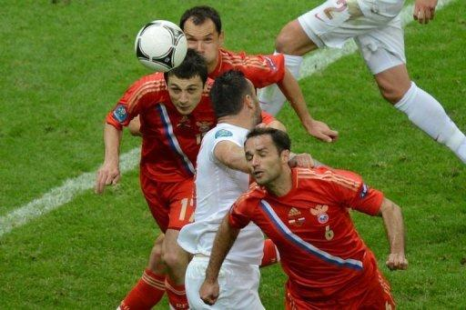 Russia's Alan Dzagoev (left) scores against Poland during the Euro 2012 match Tuesday