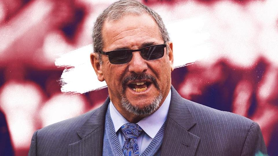 Dave Gettleman treated image sunglasses, mouth open, red background